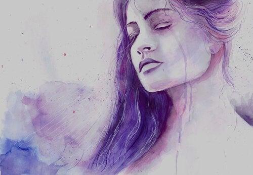 Kvinde græder over ar fra livet