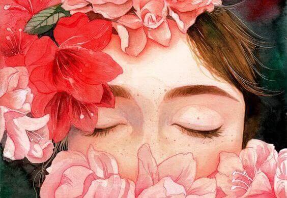 Kvinde med lukkede øjne og blomster omkring sig