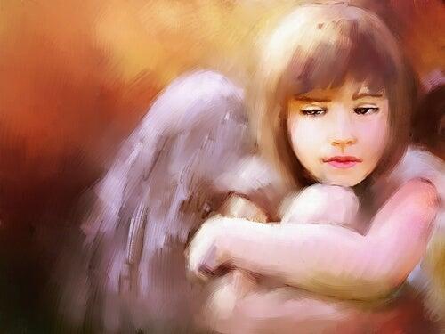 Engel krammer sig selv for at håndtere sorg