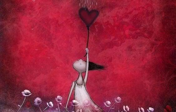 Kvinde bliver løftet op af rødt hjerte