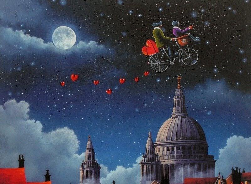 Personer på cykel i himlen med hjerter omkring