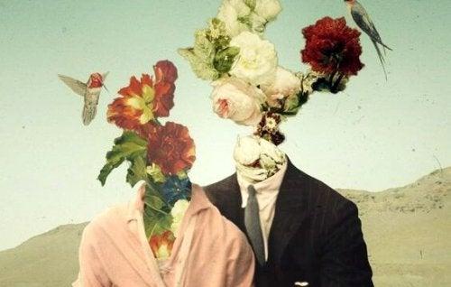 Par med blomster som hoveder