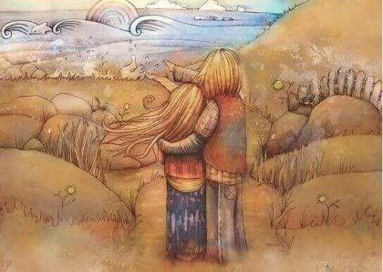 Par krammer foran landskab og nyder, at de kan tolerere mangler