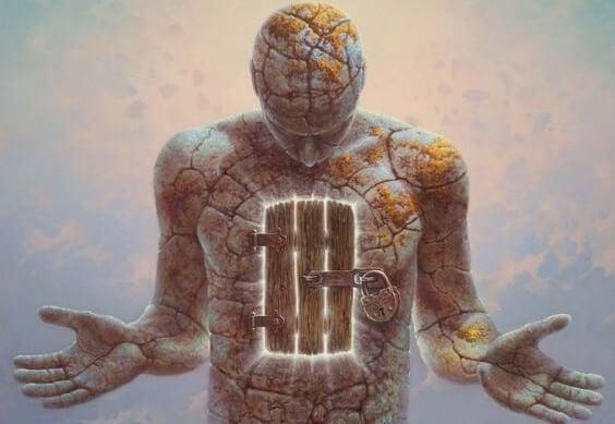 Stenmand med låge på maven symboliserer at du er dit eget fængsel