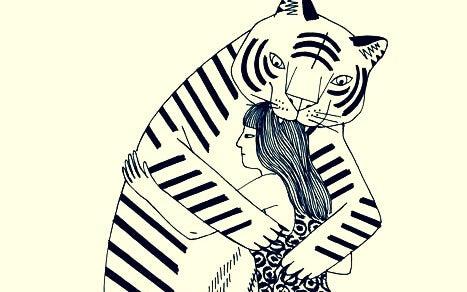 Tiger krammer kvinde
