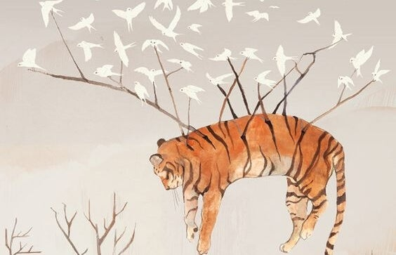 Tiger bliver båret af fugle, der vil hjælpe