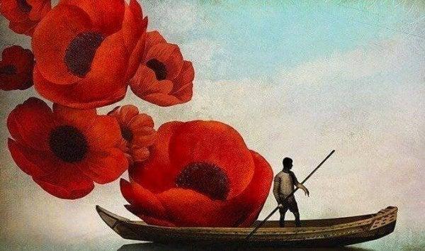 Person i båd med kæmpe blomster