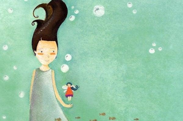 Forælder bærer barn som illustration af, hvor vigtigt det er at tro på børn