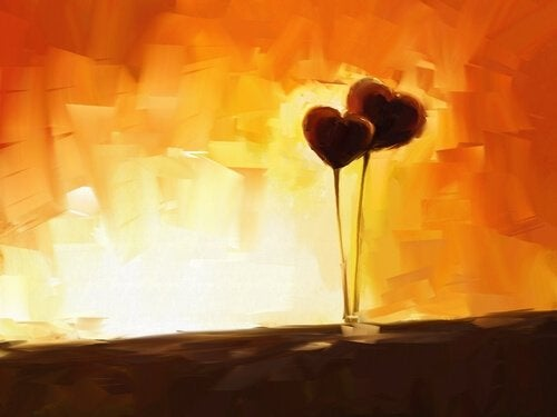 To hjerter foran orange baggrund