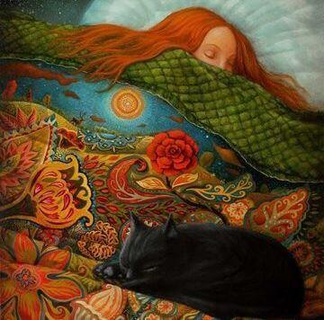 Kvinde sover med kat