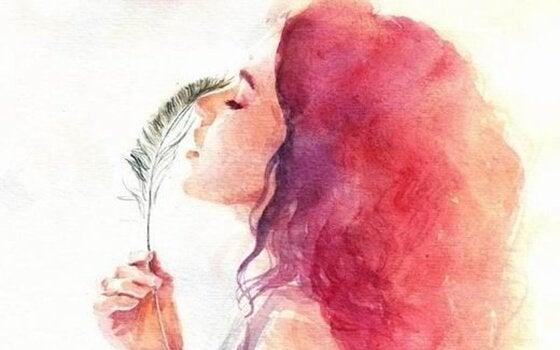 Kvinde med fjer illustrerer lidenskabeligt kunsten at elske