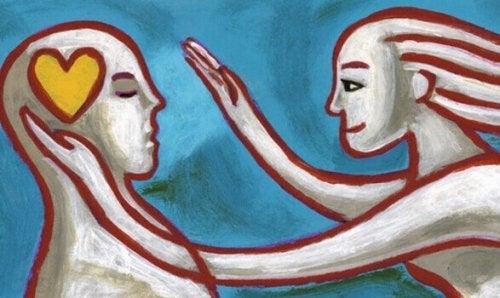 Par viser kærlighed med berøring