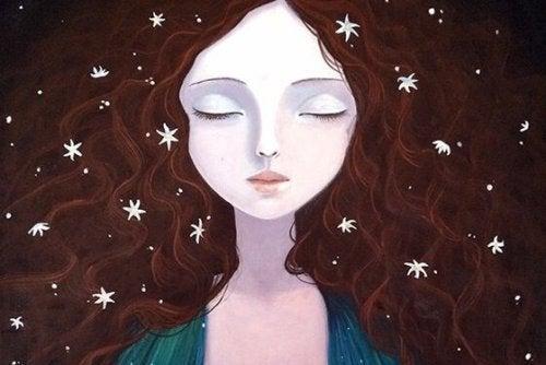 Kvinde med lukkede øjne og stjerner i håret ønsker at stoppe kognitive forvrængninger