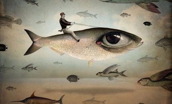 Mand rider på fisk med kæmpe øje
