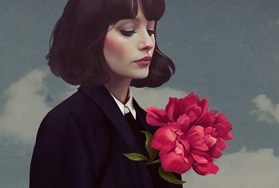 Kvinde med stor blomst er ansvarlig for sit eget liv