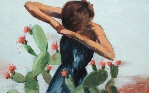 Teenager bagved kaktus