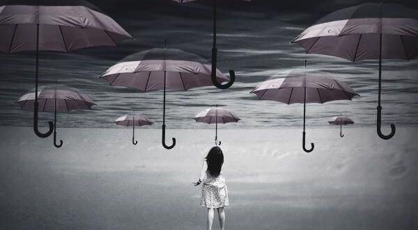 Paraplyer på spejlvendt hav