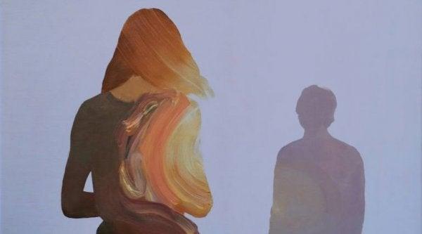 Silhuet af kvinde foran mand