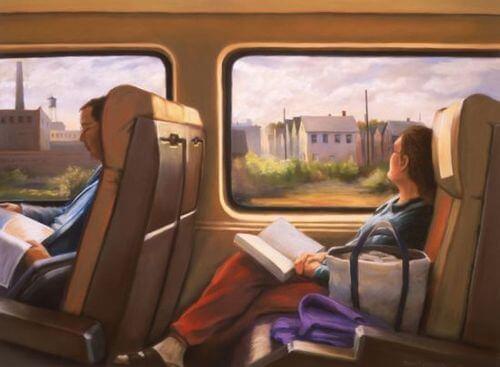 Kvinde i tog med bog