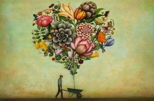 Mand går med træ af blomster i trillebør