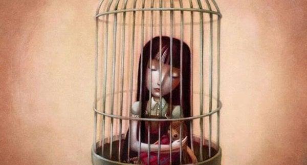 Pige i bur symboliserer selvopofrelse