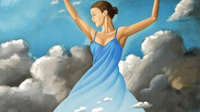 Kvinde med blå kjoler danser mellem grå skyer for at skabe et liv, der er glæden værd
