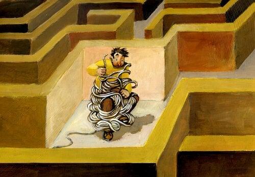 Mand viklet ind i snore i labyrint illustrerer selvsabotage