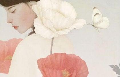 Kvinde bag blomster lider under ensomhed
