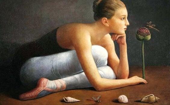 Ballerina ligger på gulv og tænker over social viden