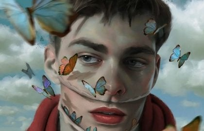 dreng med sommerfugle omkring ansigtet