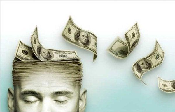 Mand med penge som hjerne