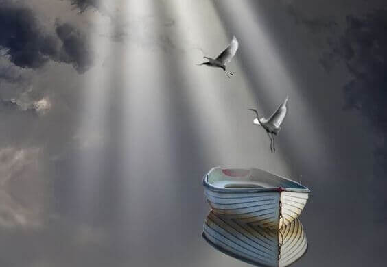 Svaner flyver over båd