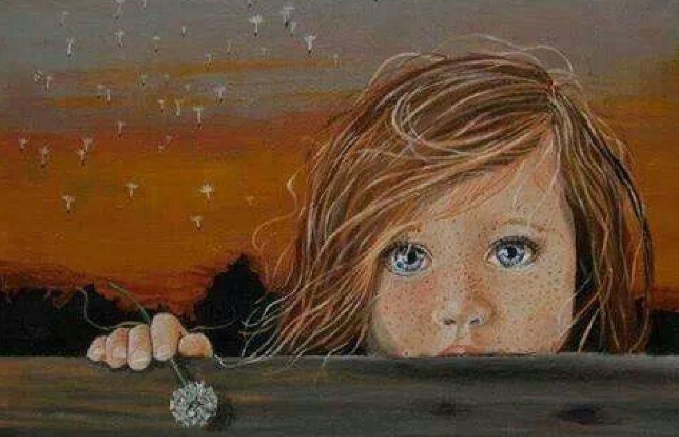 En lille pige med store øjne, der ser sit indre lys