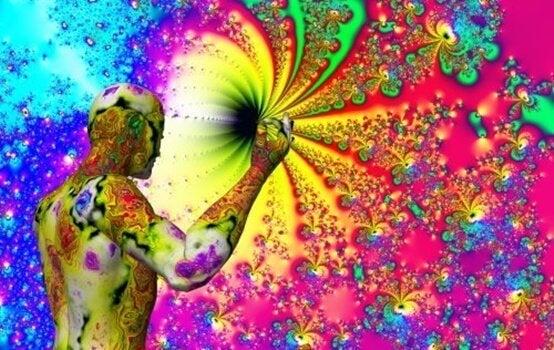 Farvestrålende billede af mand og univers illustrerer spejl-berøring synæstesi