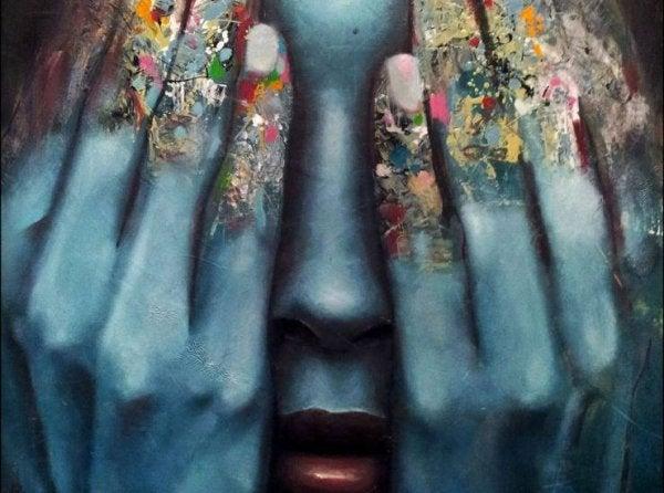Kvinde med hænder for øjnene illustrerer apati under en depression