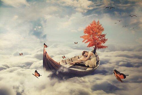 Kvinde sover på en båd