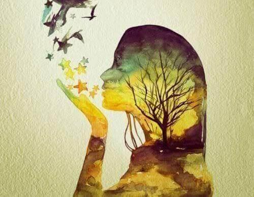 Kvinde puster farverige stjerner