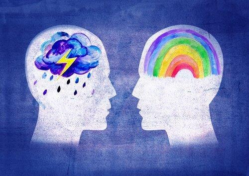 Skits af to hoveder med regnbue og regnvejr som hjerne