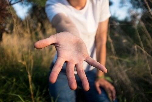 Åben hånd, som symboliserer filantropi