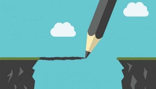 En blyant tegner en bro mellem to bjerge