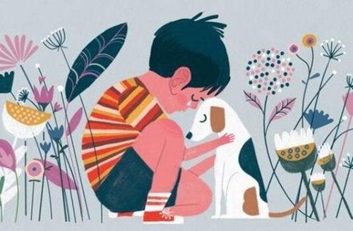 En dreng græder og krammer en hund
