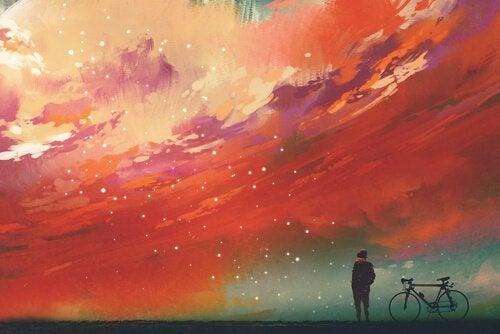 Maleri af en dreng, der ser på stjernerne på en rød himmel