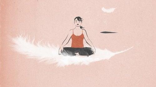 Kvinde, der flyver på en fjer