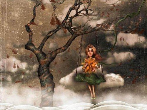 Dyster kvinde på gynge i vissent træ