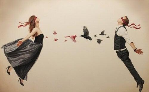 Fugle, der flyver fra mand og kvinde, illustrerer, at de vælger at ofre sig for kærligheden