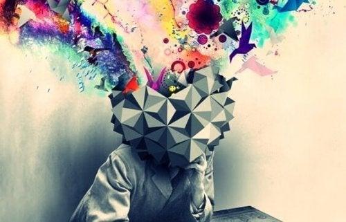 Hjerte som hoved med masser af farverige tegninger, der flyver ud af
