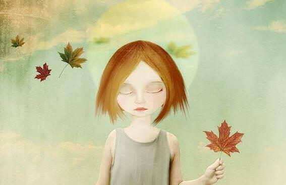 Pige med lukkede øjne og vissent blad i hånden