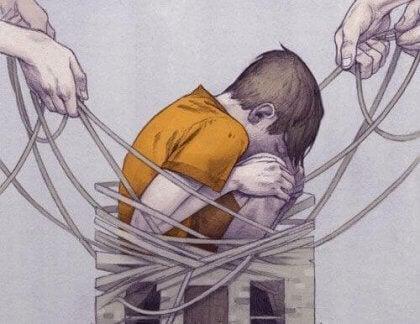 Dreng sidder bundet af snore som symbol for konsekvenserne ved mobning