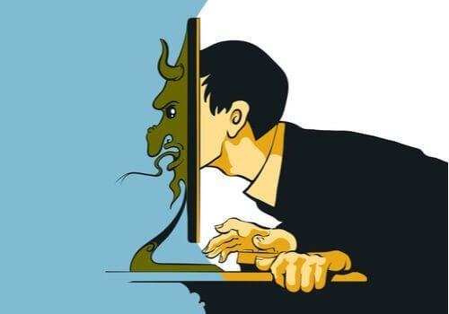 Mand med hoved i computerskærm er eksempel på trolls på sociale medier