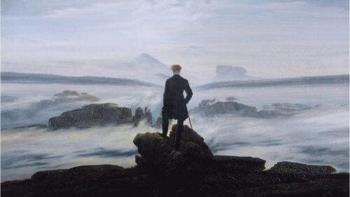 Et maleri med klipper og mand